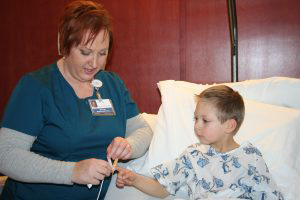 Loni Conley, RN, with young patient